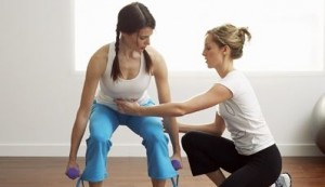 lady-personal-trainer-trains-with-dumbbell